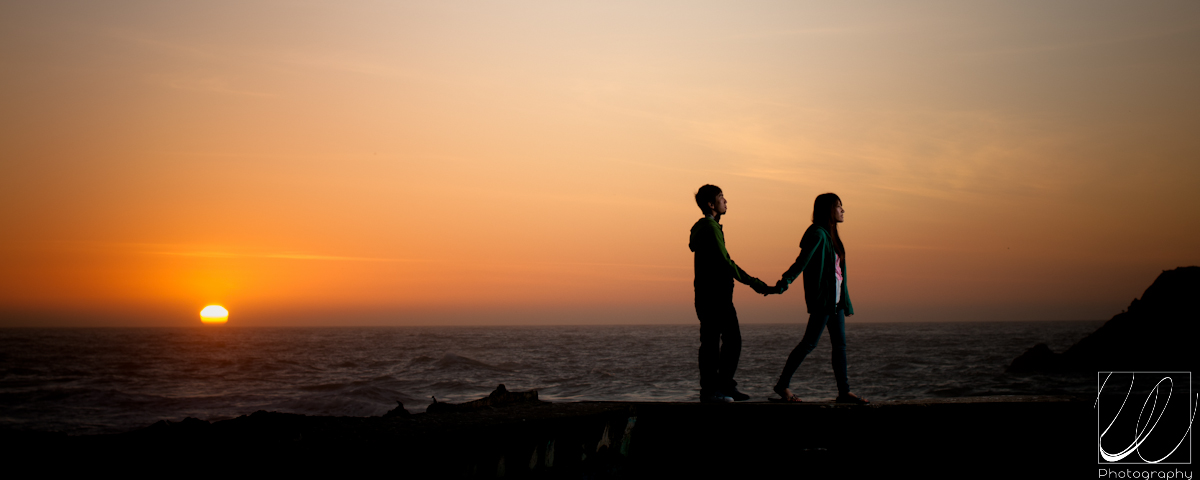 Holding Hands In Sunset. hair couple holding hands on